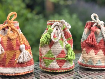 three small tapestry crochet bags