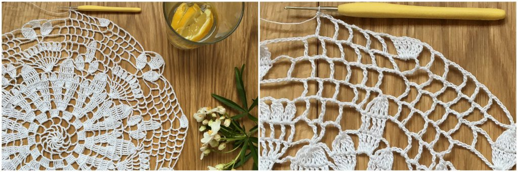 progress shot of thread crochet doily next to a sprig of mock orange and a gin and tonic